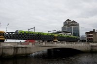 Dublin Area Rapid Transport (DART) train - DART train on the Loopline Bridge across River Liffey in Central Dublin