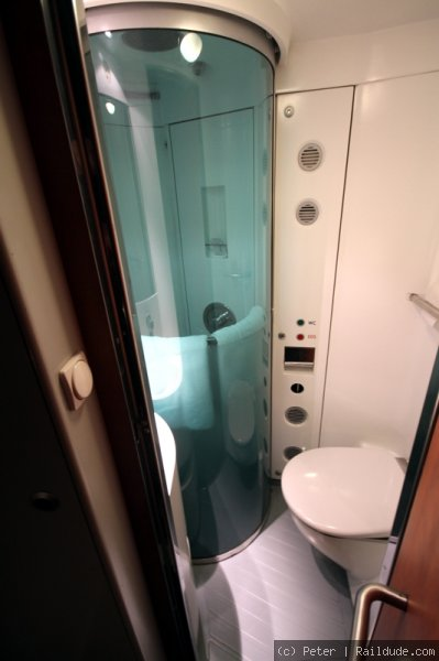 Shower with closed door in Deluxe sleeper.