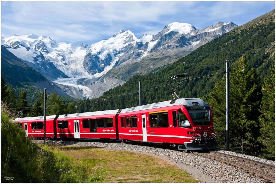 Bernina Express in Montebello Curve, in the background Morteratsch Glacier.