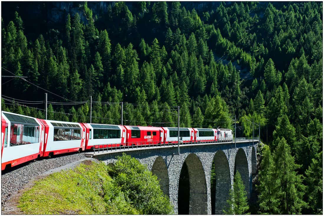 The train crosses one of the many viaducts on its way to Albula Tunnel and the Engadin.