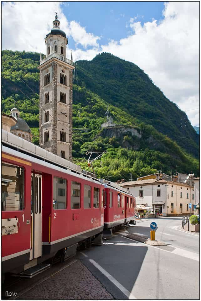 This Regio train to St Moritz has just left Tirano and passes Madonna di Tirano church.