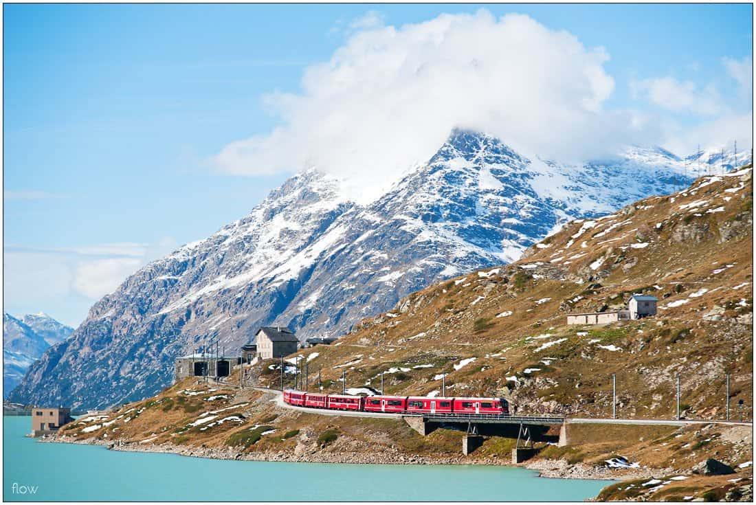 This Regio bound for Tirano has just left Ospizio Bernina station, which is still visible in the background, and starts the descend to Alp Grüm.