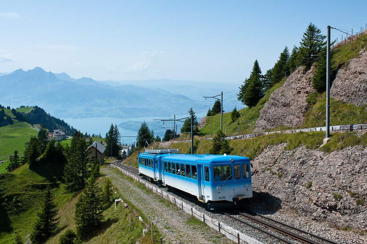 A train from Arth-Goldau is approaching Rigi Kulm station. The other track is used by trains from Vitznau.