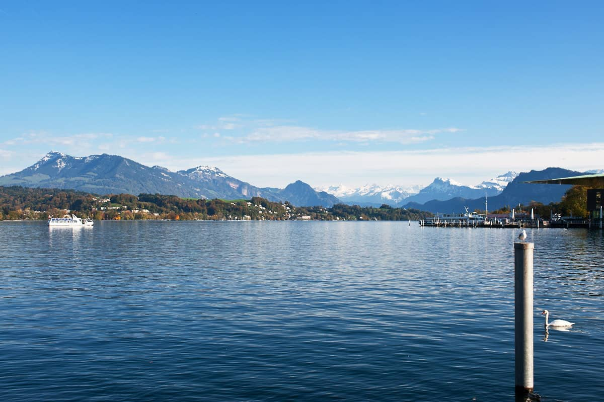 From the shore of Lake Lucerne you can see Mount Rigi on the left, the Swiss Alps in the centre and the landing stages on the right.