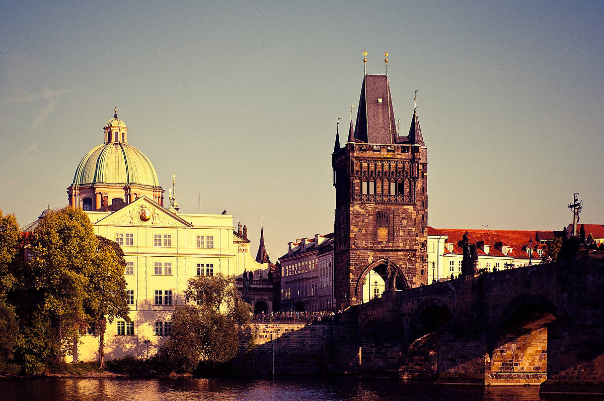 The Charles Bridge in Prague. Travel comfortably overnight with the night train...