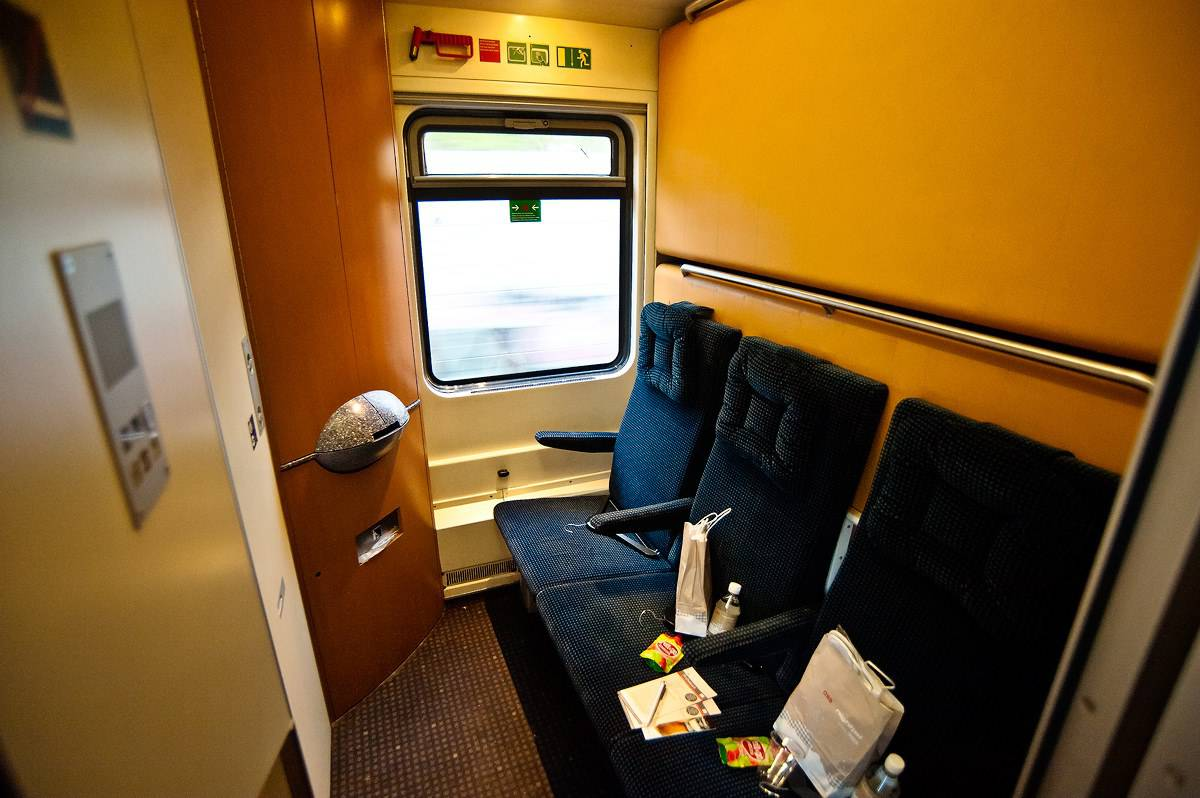 "An economy sleeping car compartment in ""day mode""."