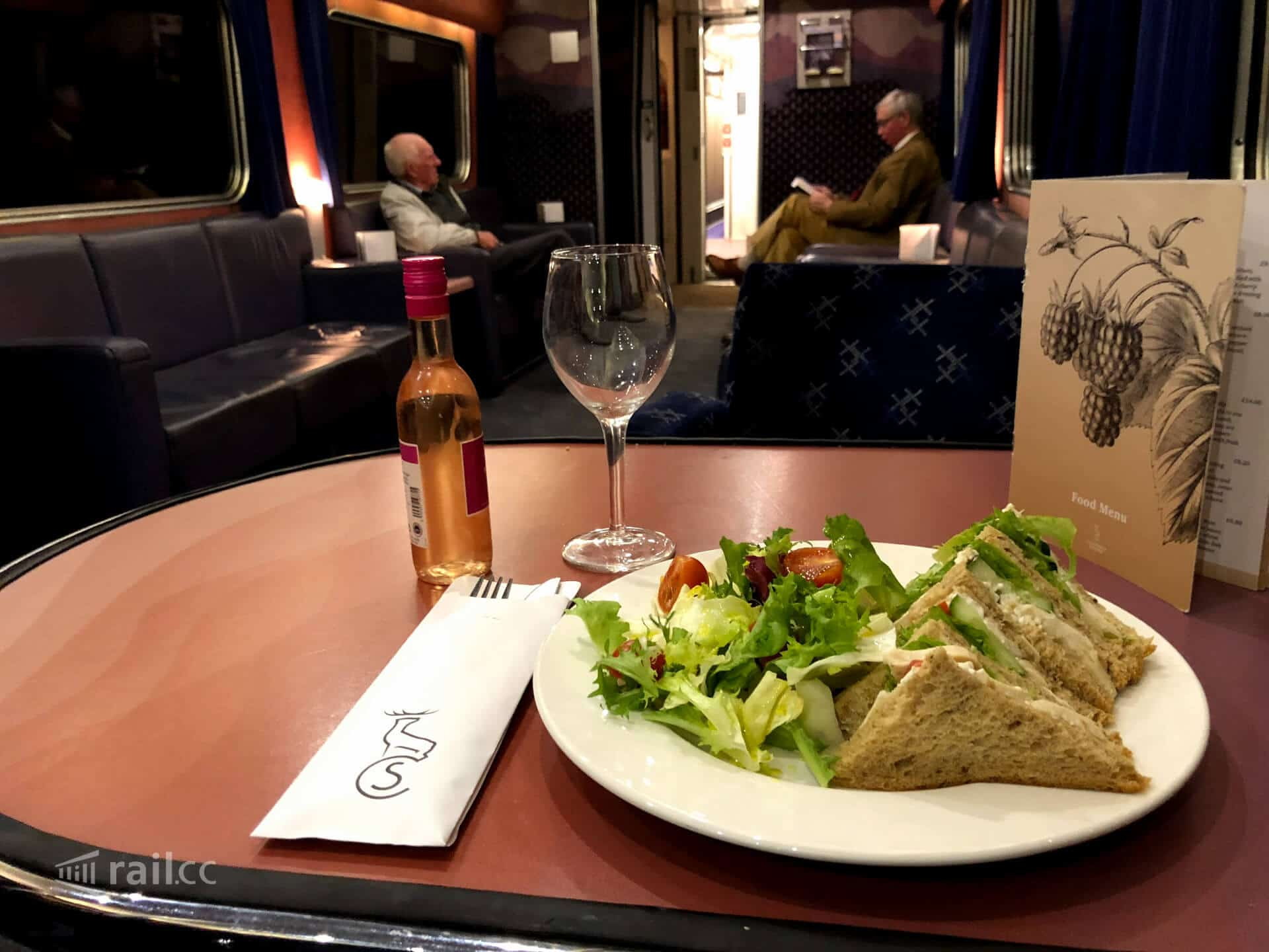 Having a sandwich at the restaurant car of the Caledonian Sleeper night train to Scotland