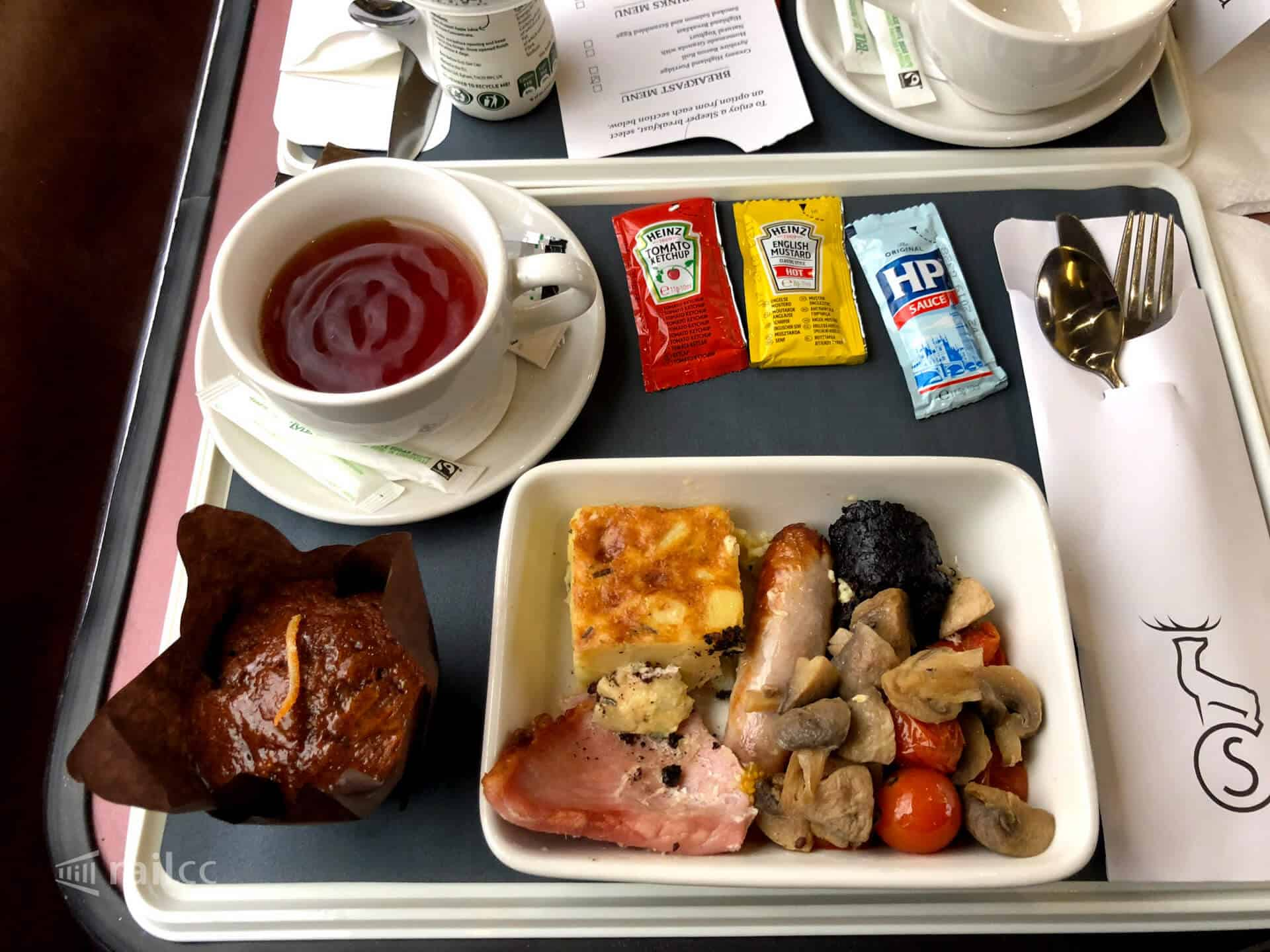 Highland breakfast with tea and assorted sauces on the Caledonian Sleeper